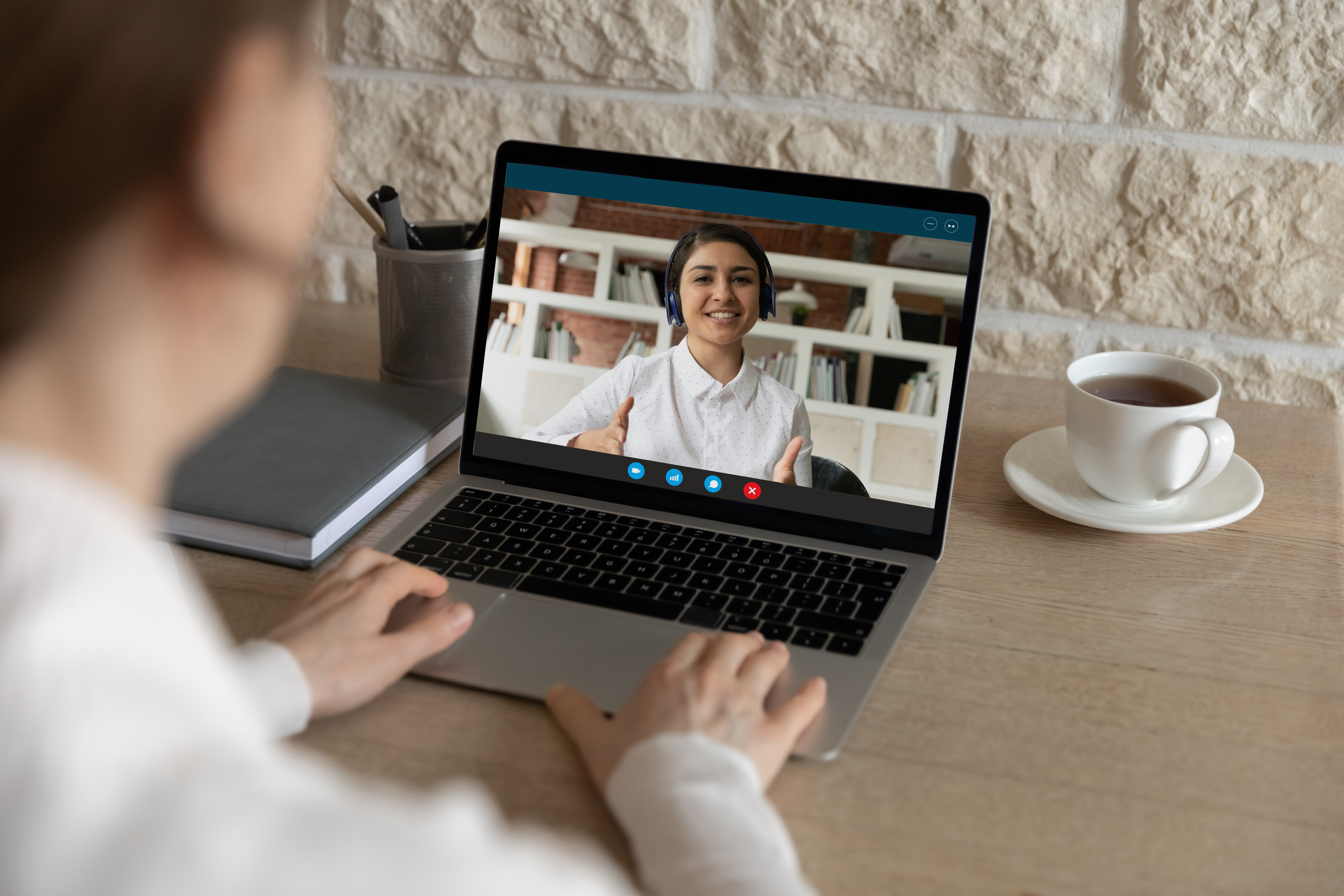 A person conducting a virtual interview on their laptop.